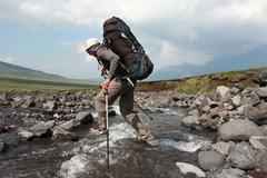 hiker in kamchatkian mountain - stock photo