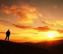 man silhouette on sunset - stock photo