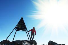 climber on top - stock photo