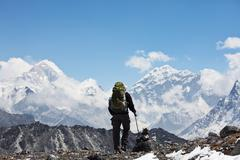 climber in himalayan mountain - stock photo