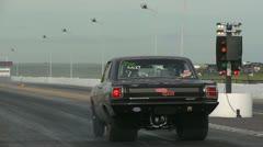 Motorsports, drag racing, black 1960s Dodge Dart launch Stock Footage