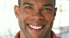 Closeup portrait of smiling African American man's face Stock Footage