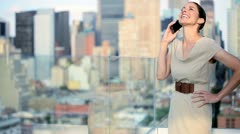 Caucasian female manager using mobile on rooftop Manhattan business office  - stock footage