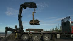Industry, Hiab crane lifting load at site, pan follow Stock Footage