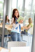 young student girl reading book at high-school - stock photo