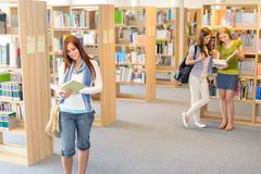 high school students at library read books - stock photo