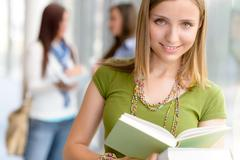 High school teenage student female read book Stock Photos