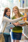 high school library happy student search book - stock photo