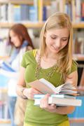 teenage student with book at high school library - stock photo