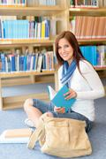 high school student at library read book - stock photo
