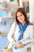 female student carry education books from library - stock photo