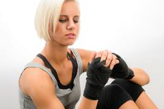 Kickbox woman put on protective gloves fitness Stock Photos