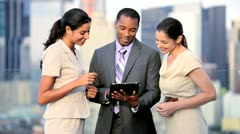 Teamwork of multi ethnic business managers analyzing finance online   - stock footage