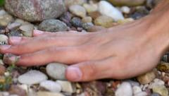 Hand touching stones - stock footage