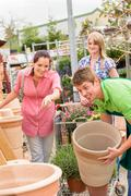customers choose flower pots in garden center - stock photo