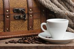cup of coffee and chest - stock photo