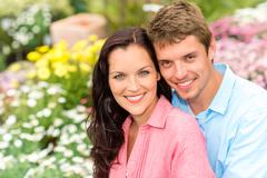 happy couple embracing in nature garden - stock photo