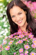 portrait beautiful woman with purple daisy flowers - stock photo