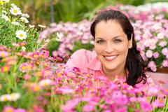 portrait beautiful woman with pink daisy flowers - stock photo