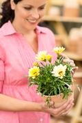Woman hold yellow potted flower Stock Photos