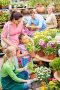 family garden center shopping for flowers - stock photo