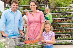 family shopping flowers at garden center - stock photo