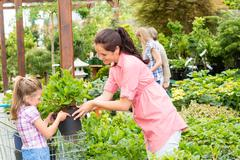 Garden center child mother shopping flowers plant Stock Photos