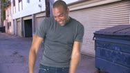 Young man in jeans and t-shirt  dancing Stock Footage