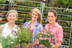 Women garden centre shop hold potted flower Stock Photos