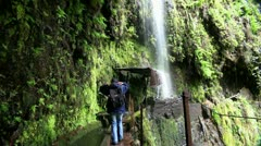Hiking girl at waterfall passage 20110429 152455 Stock Footage