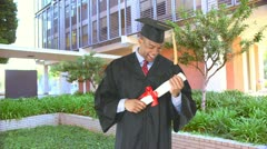 African American man with graduation gown and diploma - stock footage