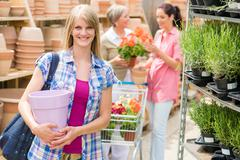 woman hold flower pot garden centre store - stock photo