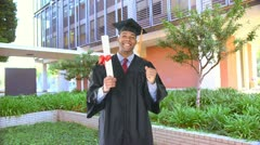 African American man with graduation gown and diploma Stock Footage