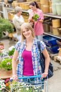 Woman with trolley shopping in garden center Stock Photos