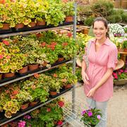 garden centre woman shopping plants - stock photo