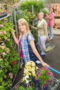 Woman at garden centre shopping for flowers Stock Photos