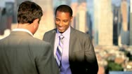 Business meeting of diverse managers ending handshake on rooftop   Stock Footage