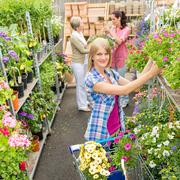 Stock Photo of woman shopping for flowers in garden shop