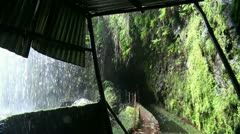 Waterfall passage with tunnel in rainforest 20110429 152621p5 Stock Footage