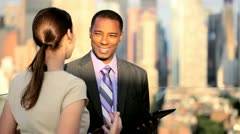 African American and Caucasian business managers planning funds on tablet  - stock footage