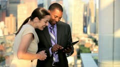 Handshake of multi ethnic business team closing contract on tablet  Stock Footage