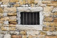 Stock Photo of old lattice window in wall