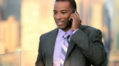 African American manager talking business strategy on mobile on rooftop   Stock Footage