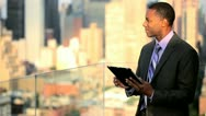 Stock Video Footage of African American business manager working on rooftop using touch screen
