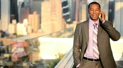 African American manager using mobile on rooftop Manhattan business office  Stock Footage