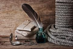letter and a quill in the inkwell - stock photo