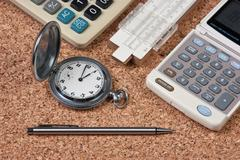 Stock Photo of pocket watch,  calculator  and slide rule