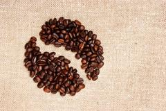 Stock Photo of coffee beans on a sack background