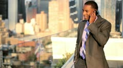 African American businessman focusing on investment banking on smart phone   - stock footage