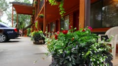 Beautiful Flowers at Small Town Hotel Jib Shot Stock Footage